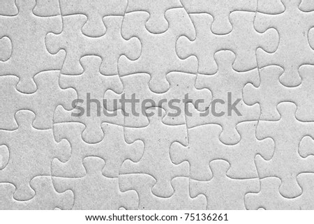 Unity:blank grey jigsaw puzzle pieces all connected, great details of textured cardboard material - stock photo