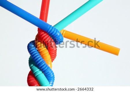 Unity. Four straws winding together in white background. - stock photo