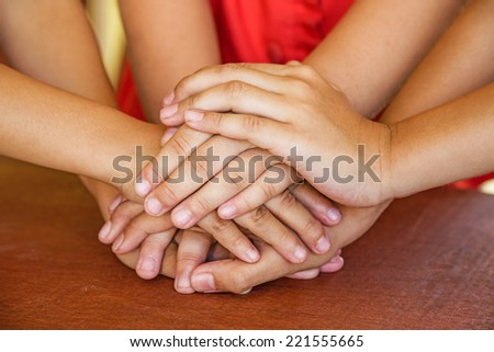 Unity with children hands together  - stock photo