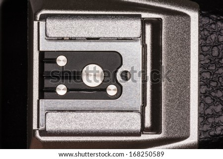 Universal accessory and flash hot shoe for a modern DSLR camera - stock photo