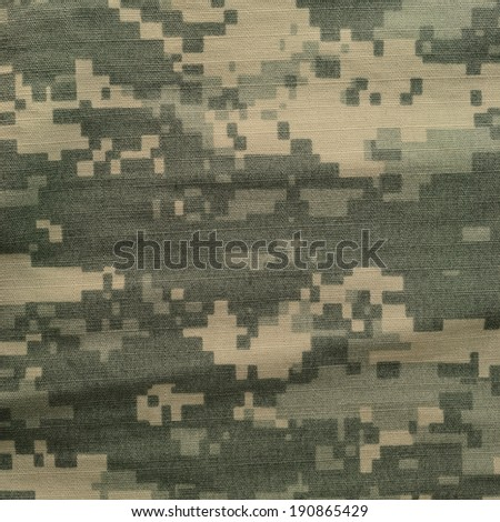 Universal camouflage pattern, army combat uniform digital camo, USA military ACU macro closeup rip-stop fabric texture background crumpled wrinkled foliage green desert sand ta - stock photo