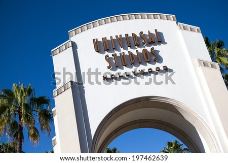 UNIVERSAL CITY,  CA - JUNE 4, 2014: The Universal Studios Hollywood sign greets visitors to the park. In 2013, Universal had 6,148,000 guests, placing it 17th in the world among North American parks. - stock photo