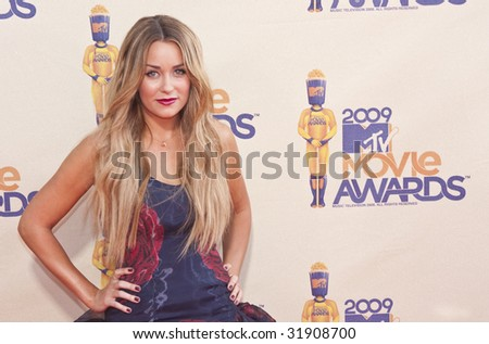 UNIVERSAL CITY, CA - MAY 31: TV personality Lauren Conrad arrives at the 18th Annual MTV Movie Awards held at the Gibson Amphitheater on May 31, 2009 in Universal City, California. - stock photo