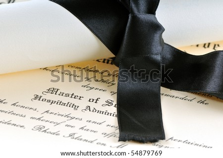 University diploma isolated on white - stock photo