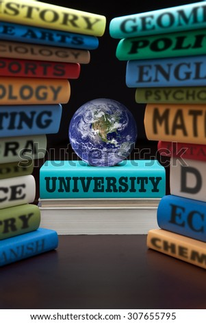 University education study books with text learning building knowledge at school, globe is courtesy of NASA, http://visibleearth.nasa.gov/. - stock photo
