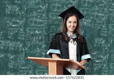 university graduate in robes with a diploma - stock photo