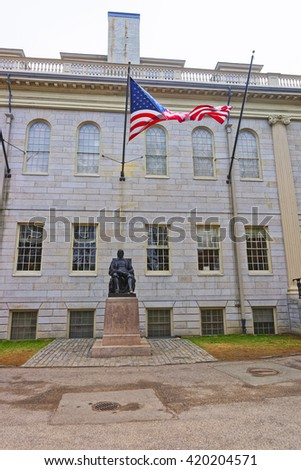 University Hall and John Harvard Statue in the campus of Harvard University of Cambridge, Massachusetts, MA, USA. It is a well-known monument of Harvard University founder in America. - stock photo