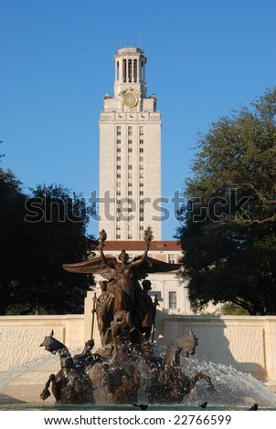 University of Texas at Austin main Tower building with Littlefield fountain in foreground - stock photo