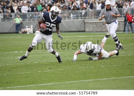 UNIVERSITY PARK, PA - APRIL 24: Penn State running back Silas Redd breaks a tackle  at Beaver Stadium April 24, 2010 in University Park, PA - stock photo