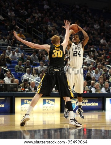 UNIVERSITY PARK, PA - FEB 16: Penn State's Cameron Woodyard shoots as Iowa's Aaron White defends during a game against Iowa at the Byrce Jordan Center February 16, 2012 in University Park, PA