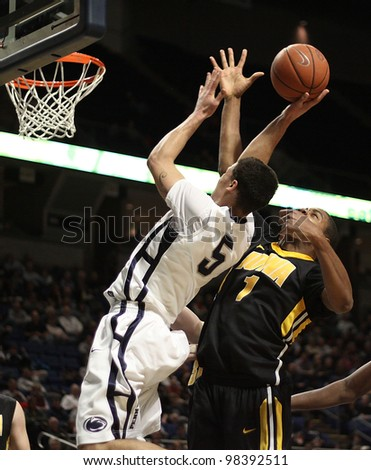 UNIVERSITY PARK, PA - FEB 16: Penn State's Matt Glover jumps high to get his shot off against Iowa at the Byrce Jordan Center on February 16, 2012 in University Park, PA