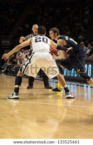 UNIVERSITY PARK, PA - FEBRUARY 27: Michigan guard Nik Stauskas looks to pass against Penn State at the Byrce Jordan Center February 27, 2013 in University Park, PA