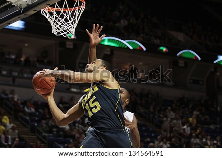 UNIVERSITY PARK, PA - FEBRUARY 27: Michigan's Jon Horrford #15  goes up strong during a game against Penn State at the Byrce Jordan Center February 27, 2013 in University Park, PA - stock photo