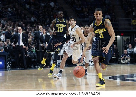 UNIVERSITY PARK, PA - FEBRUARY 27: Michigan's Trey Burke drives to the basket against Penn State at the Byrce Jordan Center February 27, 2013 in University Park, PA - stock photo
