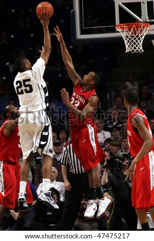 UNIVERSITY PARK, PA - FEBRUARY 24: Penn State's Jeff Brooks shots over Ohio State's David Lightyat the Byrce Jordan Center February 24, 2010 in University Park, PA