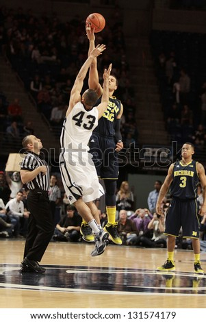 UNIVERSITY PARK, PA - FEBRUARY 27: Penn State's Ross Travis and Michigan's Jordan Morgan jump for the basketball to start a game at the Byrce Jordan Center February 27, 2013 in University Park, PA - stock photo
