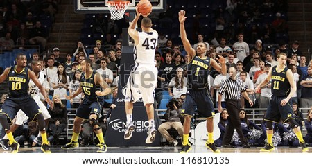 UNIVERSITY PARK, PA - FEBRUARY 27: Penn State's Ross Travis #43 shoots a jump shot against Michigan at the Byrce Jordan Center February 27, 2013 in University Park, PA  - stock photo