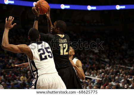 UNIVERSITY PARK, PA - JANUARY 5:  Purdue's #12 Kelsey Barlow goes for a shot over Penn State's Jeff Brooks during a game  January 5, 2011 in University Park, PA