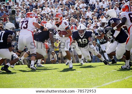 UNIVERSITY PARK, PA - OCT 9: Illinois quarterback No. 2, Nathan Scheelhaase avoids tacklers during a game against Penn State at Beaver Stadium on October 9, 2010 in University Park, PA - stock photo