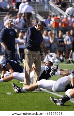 UNIVERSITY PARK, PA - OCT 9: Penn State coach Joe Paterno points his finger and talks to a player before a game against Illinois at Beaver Stadium October 9, 2010 in University Park, PA