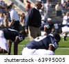 UNIVERSITY PARK, PA - OCT 9: Penn State's coach Joe Paterno watches his players warm up before a game against Illinois at Beaver Stadium October 9, 2010 in University Park, PA - stock photo