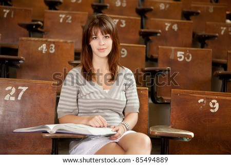 University student in lecture hall, looking at camera - stock photo