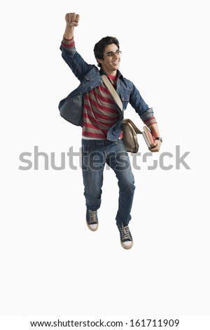 University student jumping in excitement - stock photo