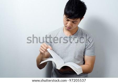 University student man read text book - stock photo