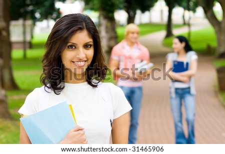 university students walking in campus - stock photo