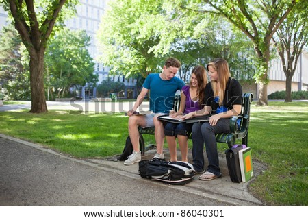 University students working together on a project - stock photo
