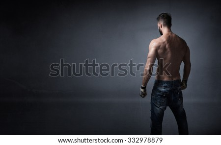 unknow athlete ready for fighting, dark background - stock photo