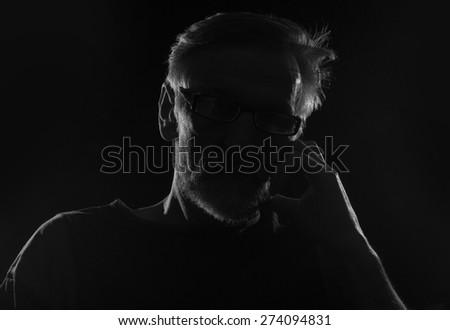 Unknown male person silhouette - stock photo