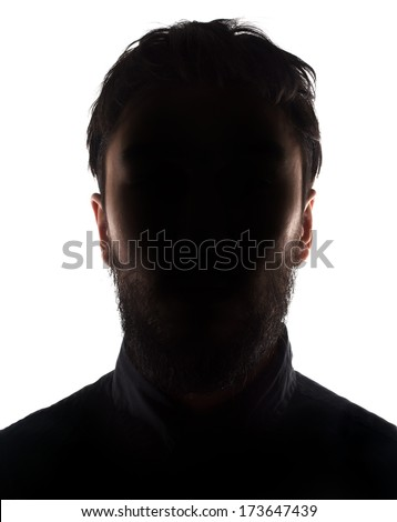 Unknown male silhouette back lit.Isolated