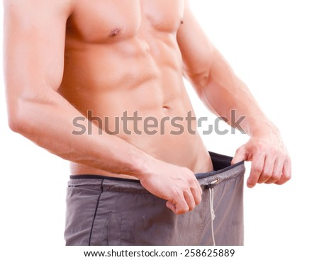 Unknown  man in the large size pants  - stock photo