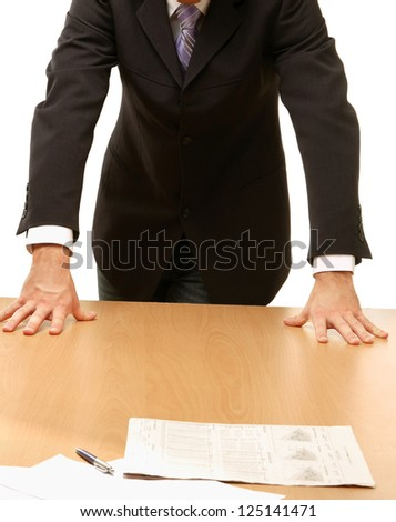 Unknown man standing near desk, isolated on white background - stock photo
