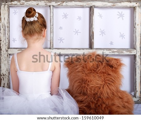 Unknown unrecognizable little girl with teddy bear, girl playing at home, artistic photo, little ballerina with teddy bear, small ballerina girl with bear in artistic photo with selective focus - stock photo