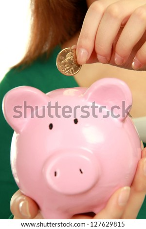 Unknown woman holding  piggy bank (money box), isolated on white background - stock photo