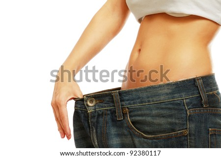 Unknown woman showing how much weight she lost isolated on white background - stock photo