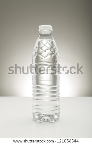 Unlabeled transparent bottle full of pure fresh water, a healthy refreshing drink to quench a thirst and rehydrate the body