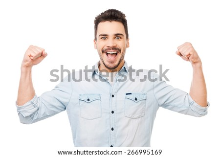 Unleashed fun. Happy young man in shirt gesturing and smiling while standing against white background - stock photo