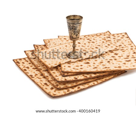 Unleavened bread and cup of whine served at Jewish Passover, isolated on white background - stock photo