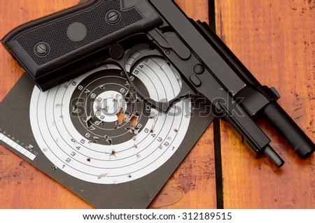 Unloaded air gun on target - stock photo