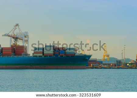 Unloading container of cargo ship port.