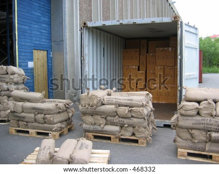 Unloading container outside a warehouse - stock photo