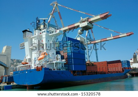 unloading of cargo ship - stock photo