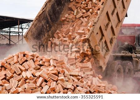 unloading of red bricks - stock photo