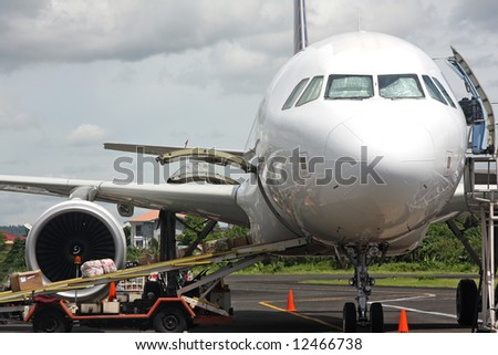 Unloading plane at Legaspi Airport, Philippines - stock photo