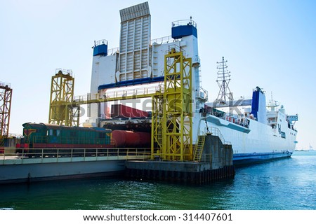 Unloading the industrial cargo ship with train locomotive. Ilyichevsk, Ukraine - stock photo
