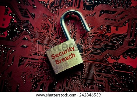 unlock security lock on computer circuit board - computer security breach concept - stock photo