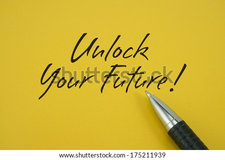 Unlock Your Future! note with pen on yellow background